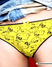 7 pictures - Cute teen in yellow panties caresses her cameltoe