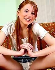 16 pictures - Teen redhead tugs on panties showing her cameltoe